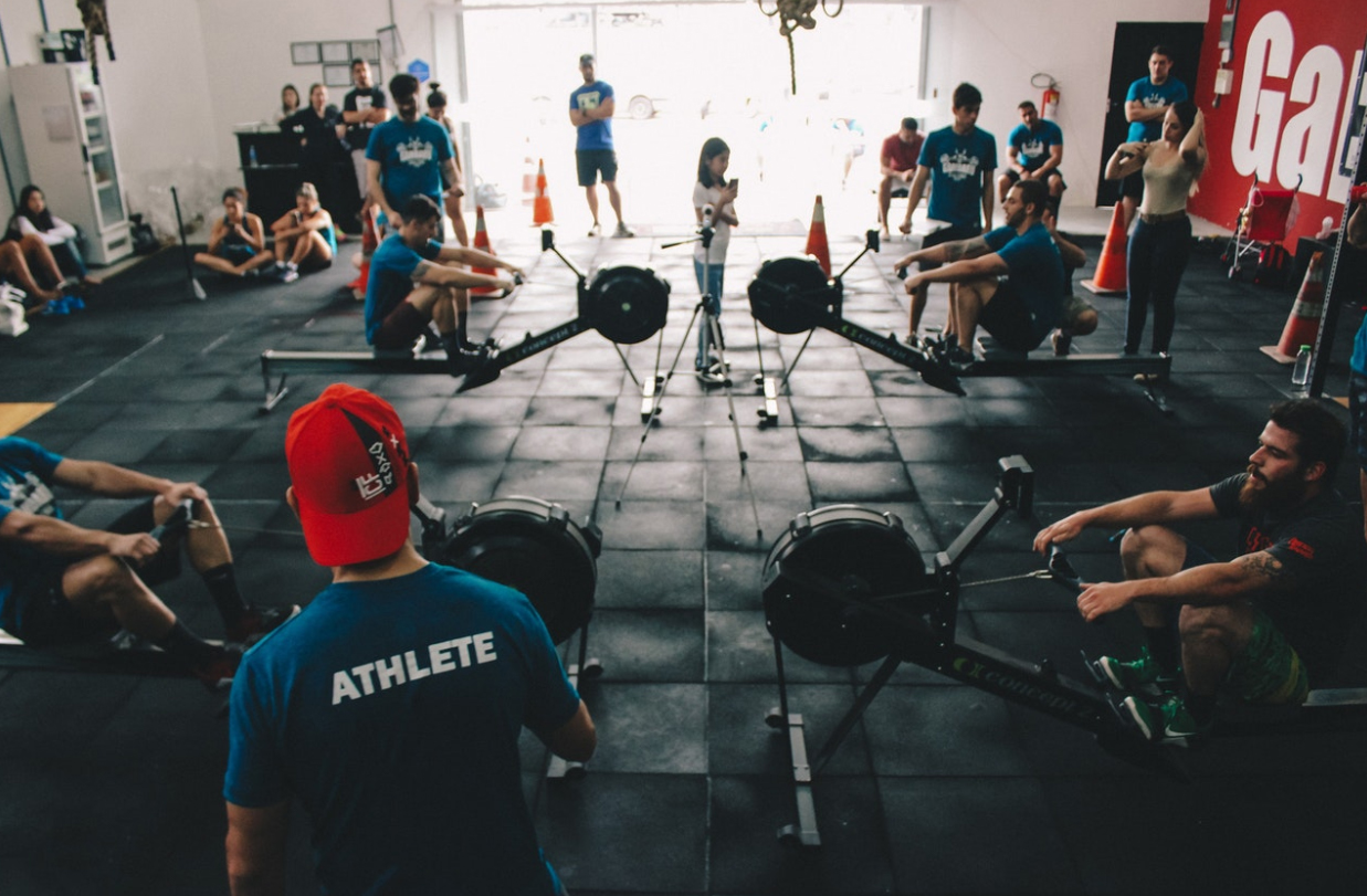 people together watching rowing in crossfit gym